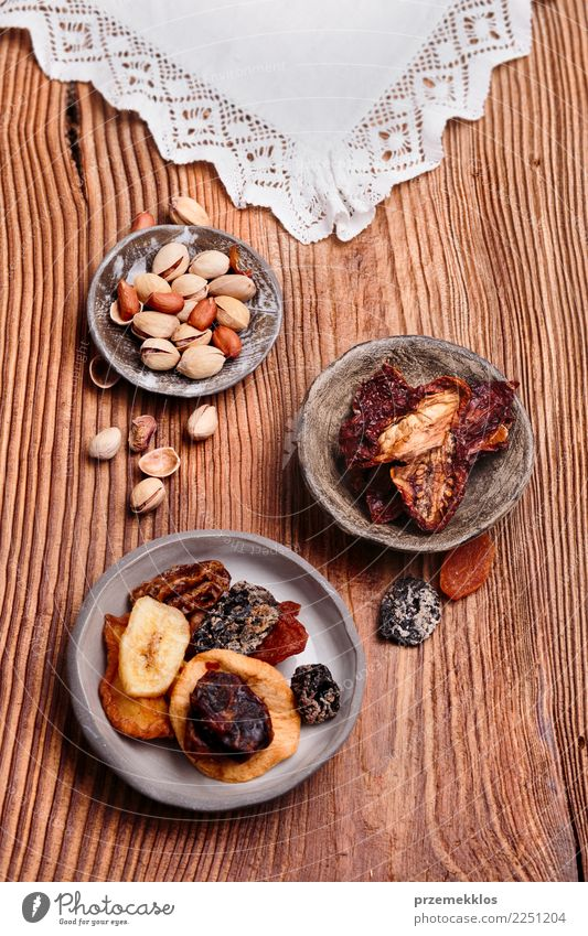 Dried fruits and nuts in handmade pottery bowls Wood Food Above Fruit Table Delicious Rust Dessert Bowl Sense of taste Rustic Snack Tasty