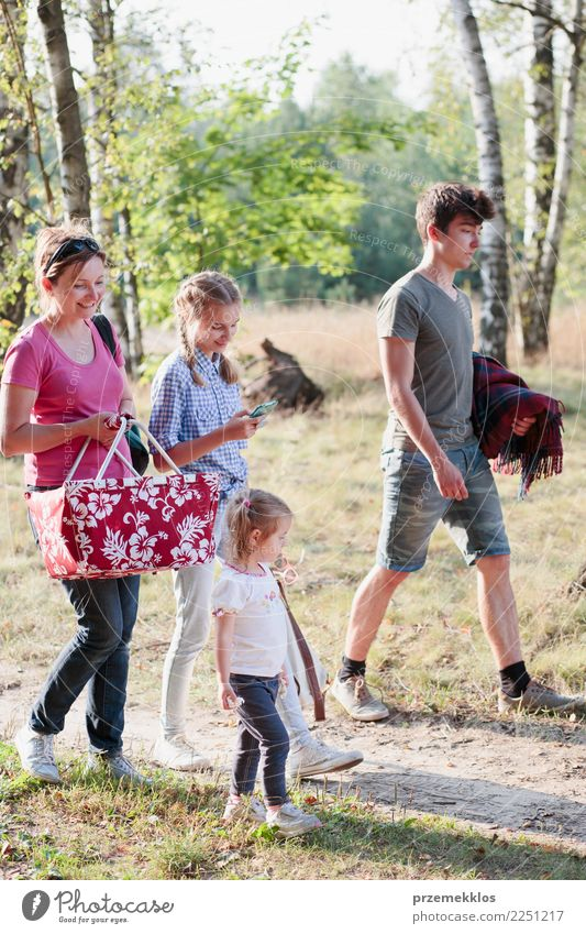 Family going on picnic to forest on sunny day Lifestyle Joy Happy Relaxation Leisure and hobbies Vacation & Travel Summer Child Girl Boy (child) Young woman