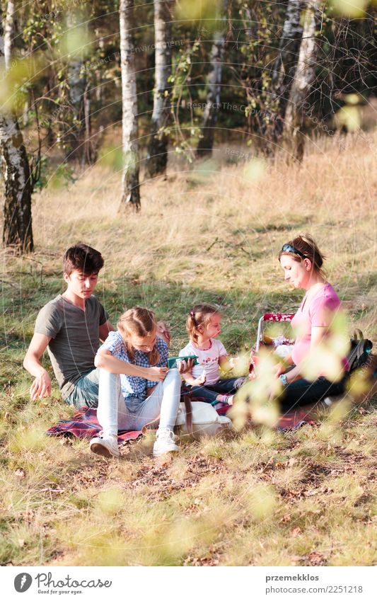 Family spending vacation time together on a picnic Lifestyle Joy Happy Relaxation Leisure and hobbies Vacation & Travel Summer Child Girl Boy (child)