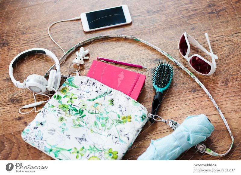 Things pulled out of handbag Lifestyle Style Contentment Telephone Cellphone PDA Accessory Pen Above brush glasses Handbag Headphones key mobile notebook