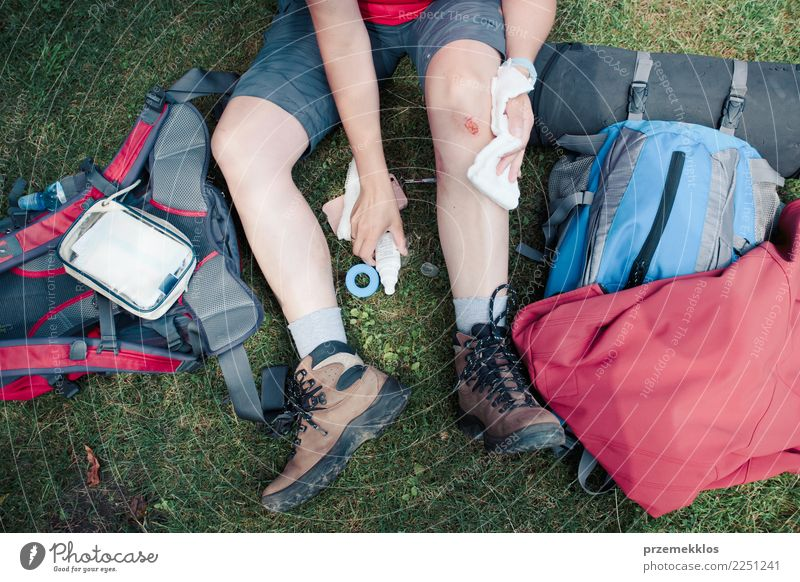 Woman dressing the wound on her knee with medicine in spray Lifestyle Vacation & Travel Summer Hiking Sports Human being Adults Legs 1 18 - 30 years