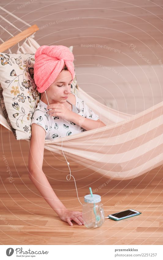 Girl with towel on head using mobile phone in hammock Lifestyle Shopping Child Telephone Cellphone PDA Technology Human being Young woman Youth (Young adults) 1