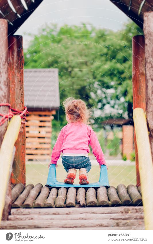 Little toddler girl playing in the playground standing on slide Joy Happy Summer Garden Child Toddler Girl Infancy 1 Human being 3 - 8 years Park Playground