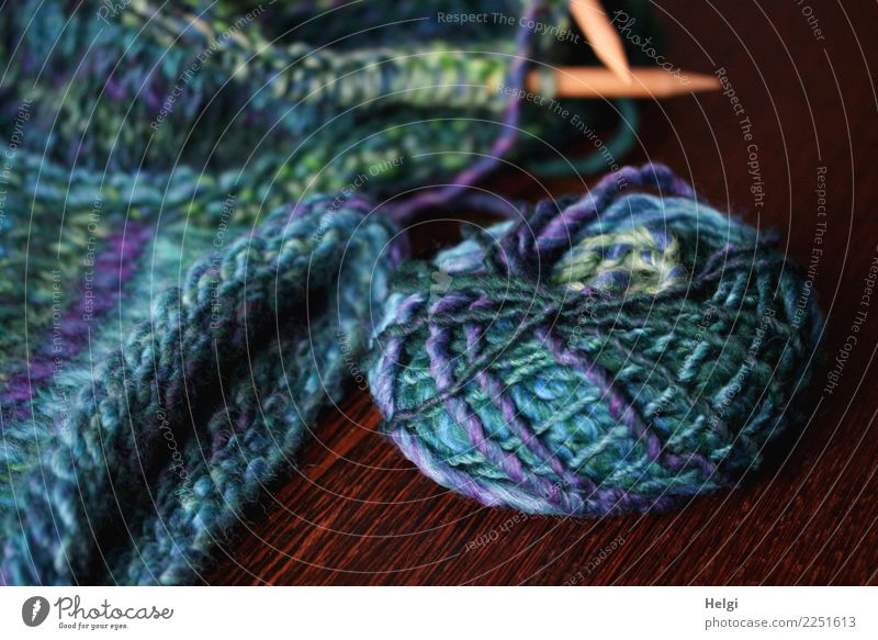 Knitting leisure fun. Wool Knot Knitting needle Loop Wood Lie Beautiful Uniqueness Soft Blue Brown Green Turquoise Joy Conscientiously Patient Diligent