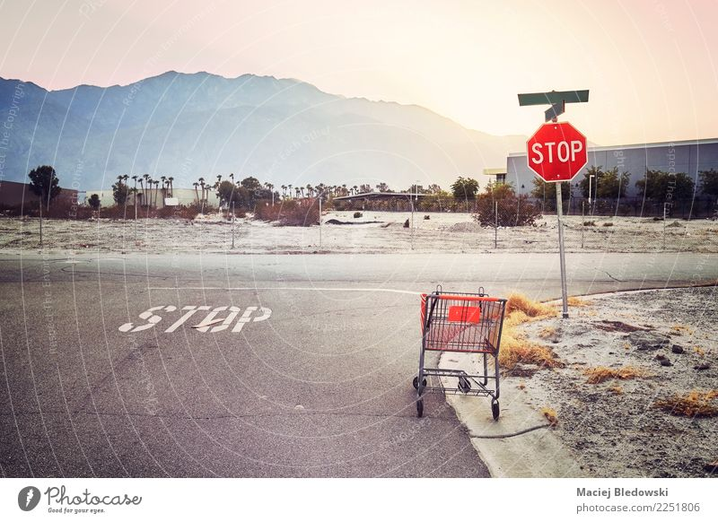 Abandoned shopping cart on a street at sunset. Street Retro Gloomy USA Shopping Money Fear of the future Fatigue Highway Storage Frustration Crossroads Basket
