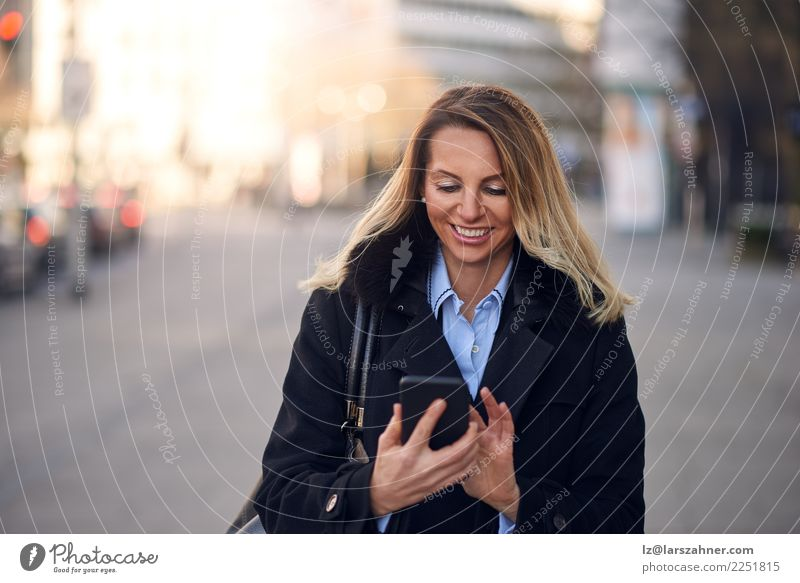 Fashionable Woman Busy with Phone at City Street Lifestyle Reading Vacation & Travel Telephone PDA Technology Adults 1 Human being 45 - 60 years Town Transport