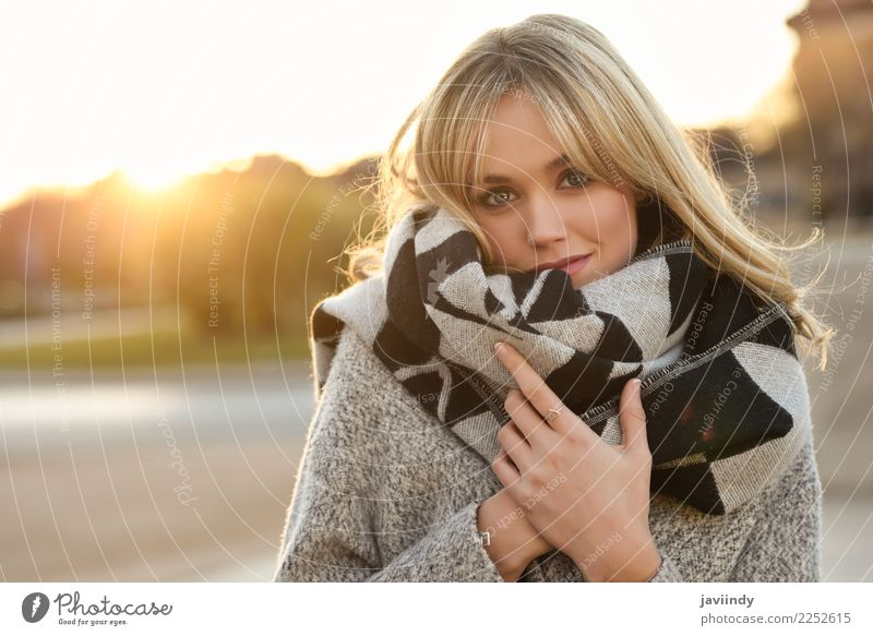 Young blonde woman in urban background at Sunset Woman Human being Youth (Young adults) Young woman Beautiful White Winter 18 - 30 years Face Street Adults