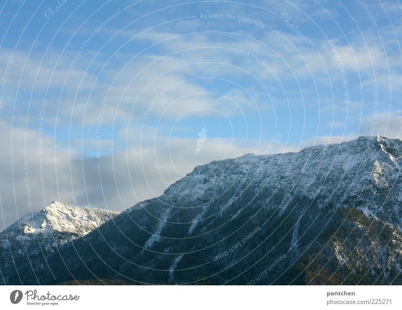 excursion day Trip Winter Snow Mountain Rock Snowcapped peak Blue Sky Clouds Freedom Impressive Colour photo Exterior shot Copy Space top Day Clouds in the sky
