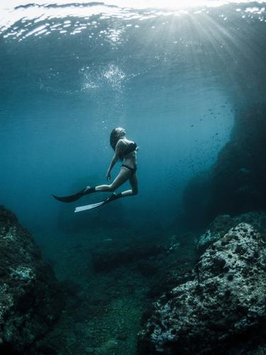 Free diving Skin Relaxation Sun Ocean Winter Sports Dive Woman Adults Nature Clouds Breathe Vacation & Travel Swimming & Bathing Simple Eroticism Far-off places