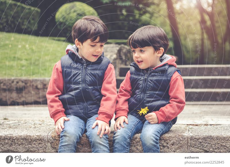 happy brothers sitting in the park Child Human being Flower Joy Lifestyle Love Emotions Family & Relations Boy (child) Happy Garden Together Friendship