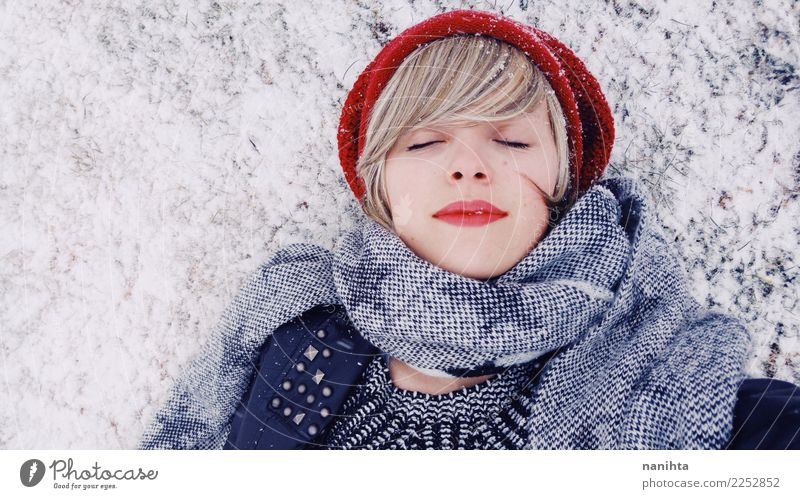 Young woman lying down over a snowy floor Human being Youth (Young adults) Christmas & Advent Beautiful Relaxation Winter 18 - 30 years Adults Lifestyle Cold