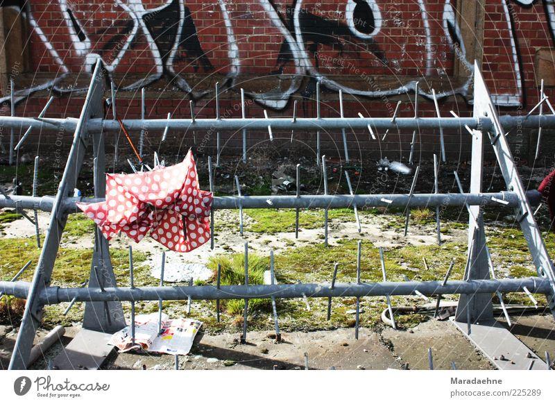 Umbrella-ella-ella-e-e-e Deserted Bridge Wall (barrier) Wall (building) Barbed wire Newspaper Sign Characters Graffiti Aggression Poverty Dirty Sharp-edged