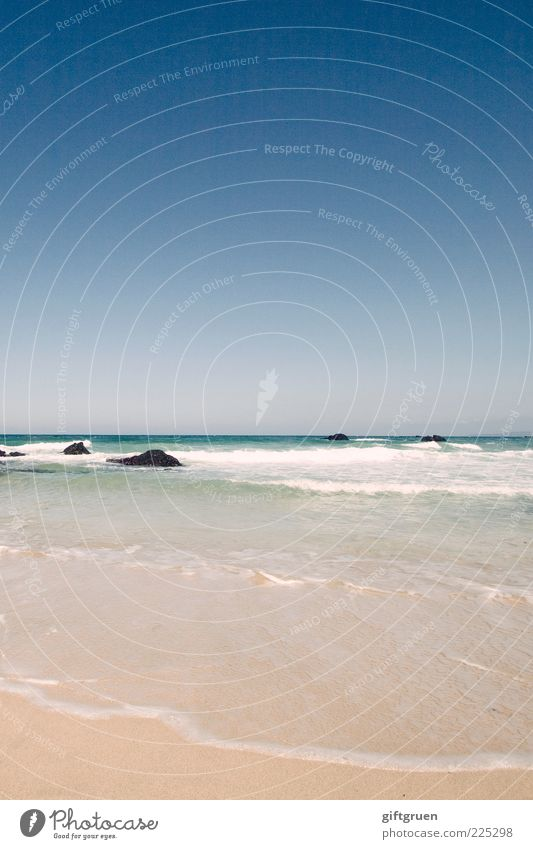 waves of indifference Environment Nature Landscape Elements Sand Water Sky Cloudless sky Horizon Summer Weather Beautiful weather Waves Coast Beach Ocean Blue