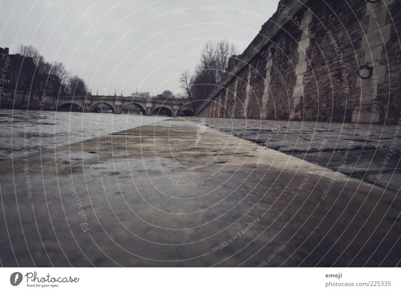 dreariness River bank Bridge Wall (barrier) Wall (building) Old Cold Ground Stone Stone wall Stone floor Gloomy Gray Colour photo Exterior shot Evening
