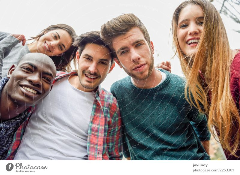 Multiracial group of friends taking selfie in a urban park Lifestyle Joy Happy Beautiful Leisure and hobbies Vacation & Travel Telephone PDA Camera Technology