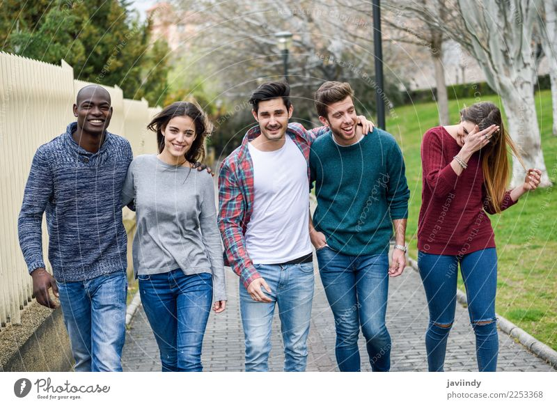 Group of multi-ethnic young people walking together Woman Human being Youth (Young adults) Man Young woman Young man Joy 18 - 30 years Street Adults Lifestyle