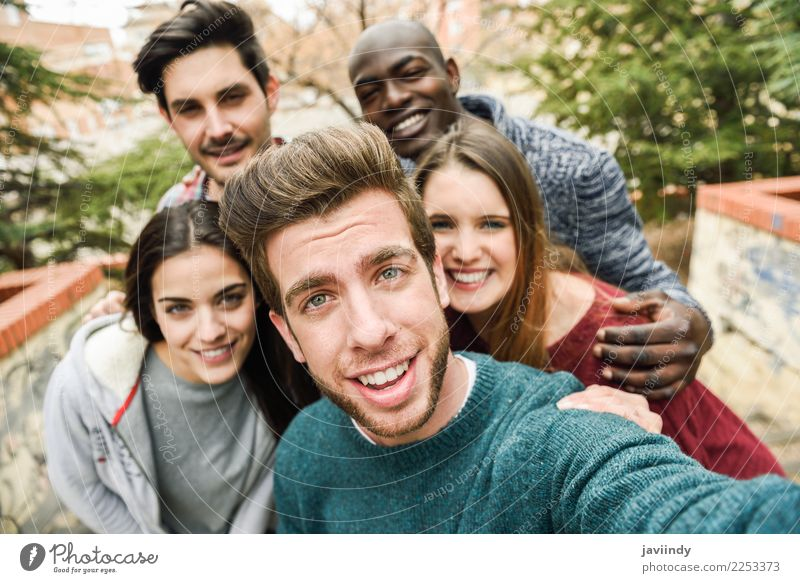 Multiracial group of friends taking selfie together Lifestyle Joy Vacation & Travel Telephone PDA Camera Technology Human being Young woman Youth (Young adults)