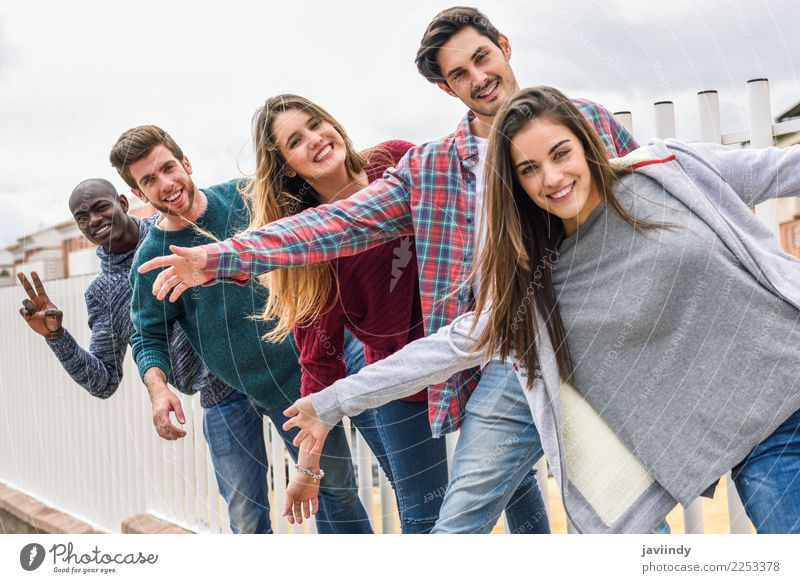 Group of multi-ethnic young people having fun together outdoors in urban background Lifestyle Joy Happy Academic studies Human being Young woman