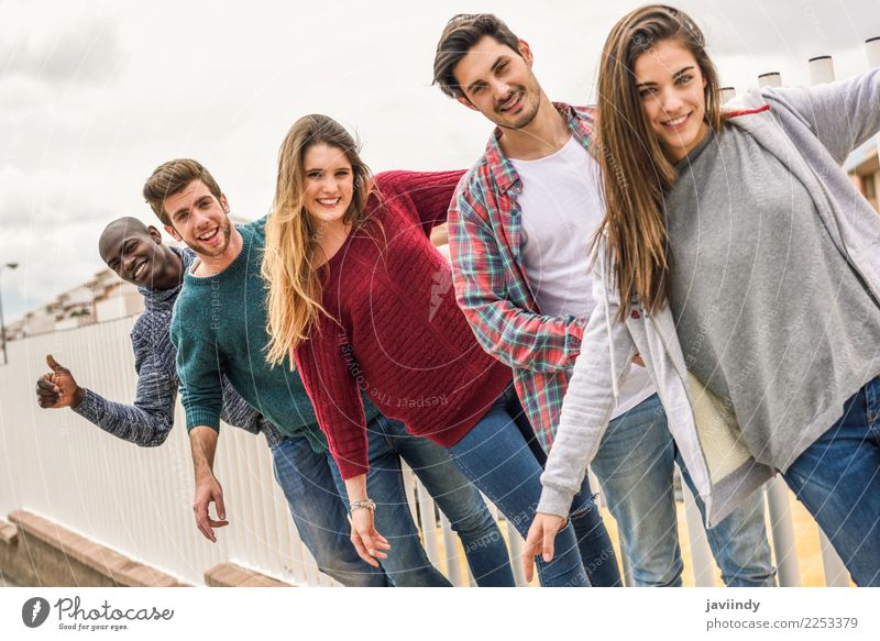 Group of multi-ethnic young people having fun together outdoors in urban background Lifestyle Joy Academic studies Human being Young woman Youth (Young adults)