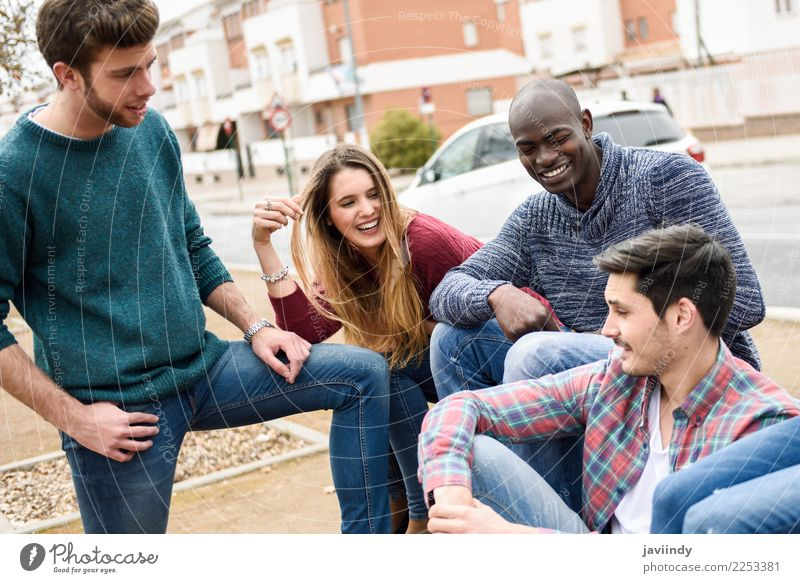 Group of multi-ethnic young people having fun together outdoors in urban background Lifestyle Joy Happy Academic studies Human being Young man