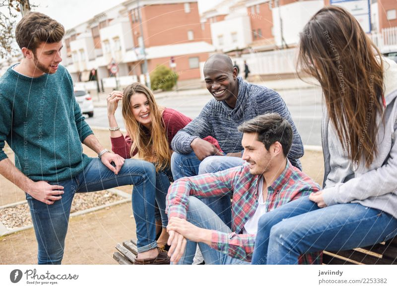 Group of multi-ethnic young people having fun together outdoors in urban background Lifestyle Joy Human being Young woman Youth (Young adults) Young man Woman