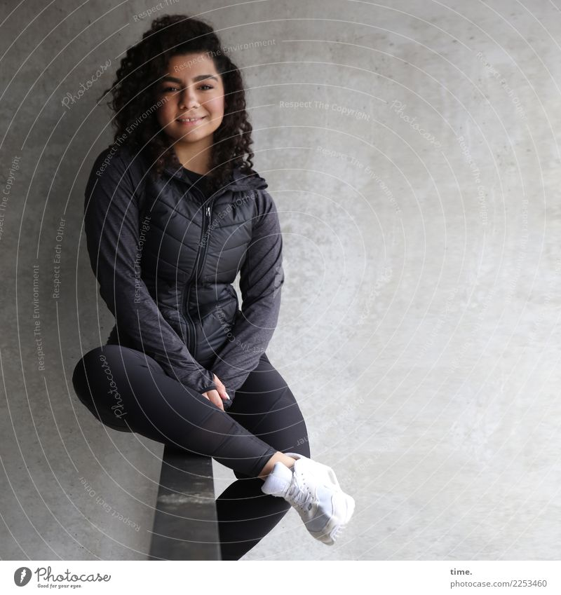 Nikoliya Feminine Woman Adults 1 Human being Wall (barrier) Wall (building) Handrail Pants Jacket Sneakers Brunette Long-haired Curl Observe Smiling Laughter