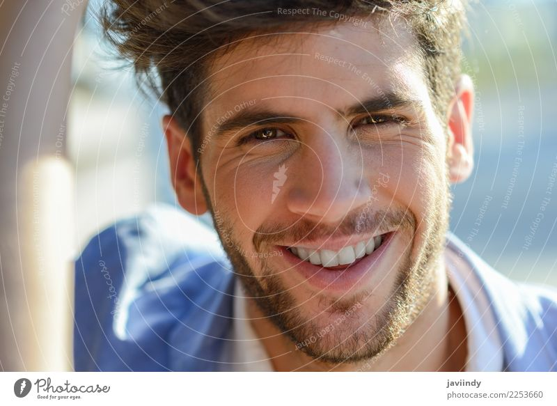 Young man smiling in urban background Human being Youth (Young adults) Man Summer 18 - 30 years Face Adults Autumn Emotions Hair and hairstyles Fashion