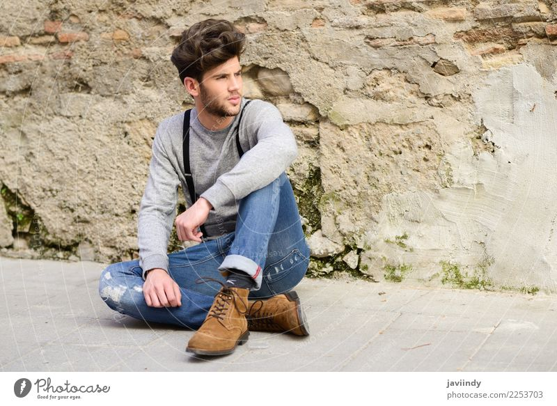 Young man sitting on the floor in urban background Lifestyle Style Hair and hairstyles Summer Human being Masculine Youth (Young adults) Man Adults 1