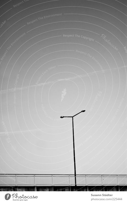 T Street Lanes & trails Bridge Lantern Bridge railing Handrail Gloomy Vapor trail Cloudless sky Black & white photo Exterior shot Deserted Copy Space top Dawn