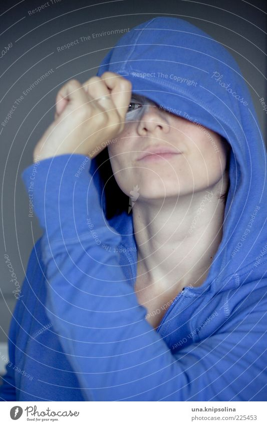 blue Feminine Young woman Youth (Young adults) Woman Adults 1 Human being 18 - 30 years Sweater Hooded (clothing) Smiling Curiosity Blue Concealed Hide