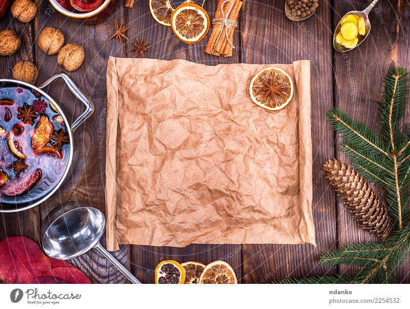 paper and ingredients for making mulled wine Christmas & Advent Dish Yellow Wood Brown Above Retro Table Paper Herbs and spices Beverage Hot New Year's Eve