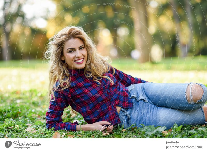 Woman smiling on the grass of a urban park Lifestyle Joy Happy Beautiful Hair and hairstyles Relaxation Human being Feminine Young woman Youth (Young adults)