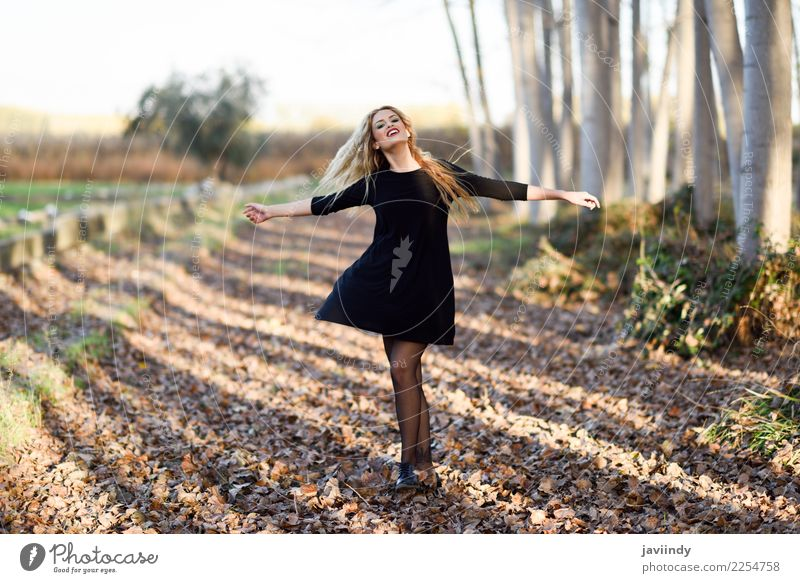 Young blonde woman dancing in poplar forest Woman Human being Nature Youth (Young adults) Beautiful White Joy 18 - 30 years Adults Autumn Natural Emotions Happy