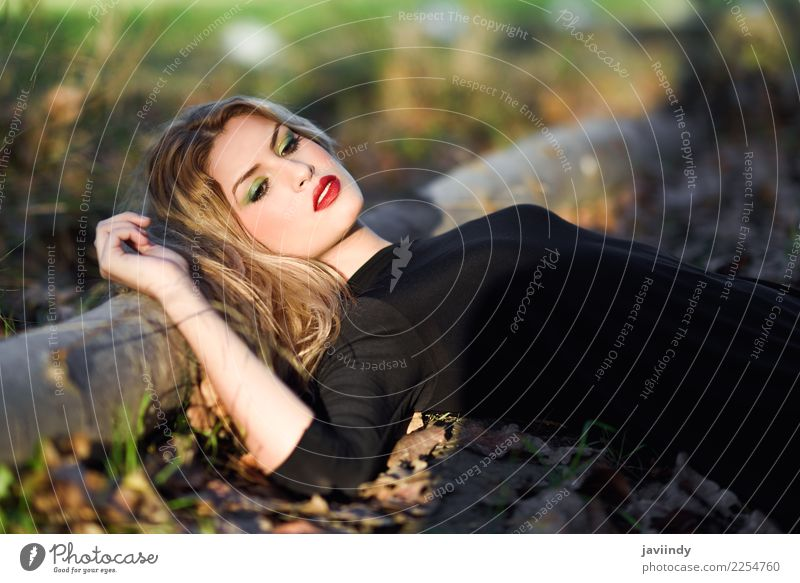 Relaxed girl lying on the field with long curly hair Beautiful Hair and hairstyles Face Make-up Human being Feminine Young woman Youth (Young adults) Woman