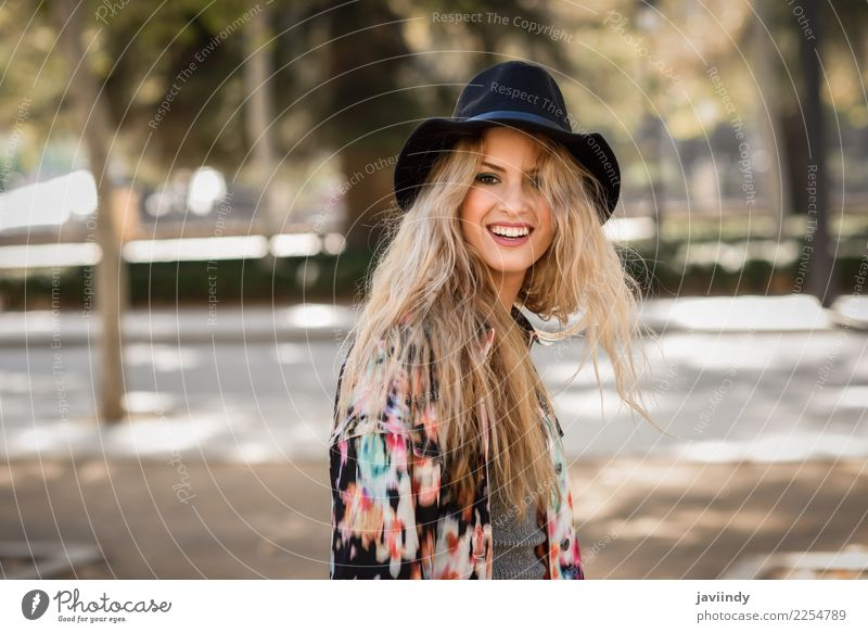 Smiling blond woman with hat in urban background Woman Human being Youth (Young adults) Young woman Beautiful White Street Adults Autumn Natural Feminine Happy