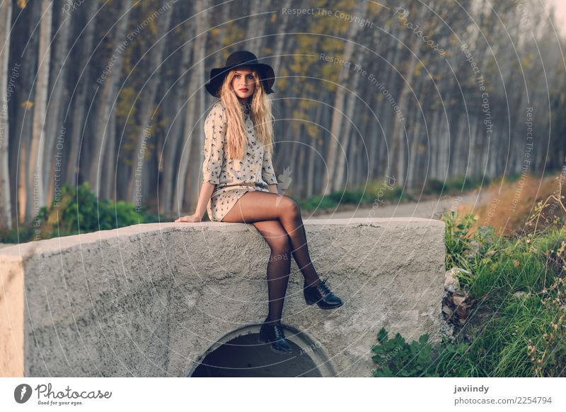 Blond woman with curly hair in a rural road wearing dress Woman Human being Nature Youth (Young adults) Beautiful White 18 - 30 years Adults Autumn Natural