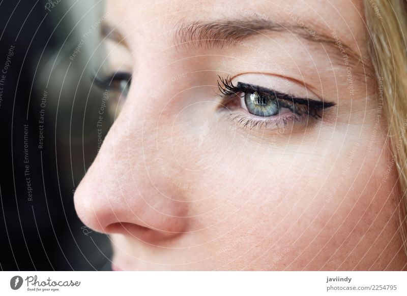Young woman's eye. Woman with blue eyes. Human being Youth (Young adults) Blue Beautiful Green White 18 - 30 years Face Eyes Adults Natural Feminine