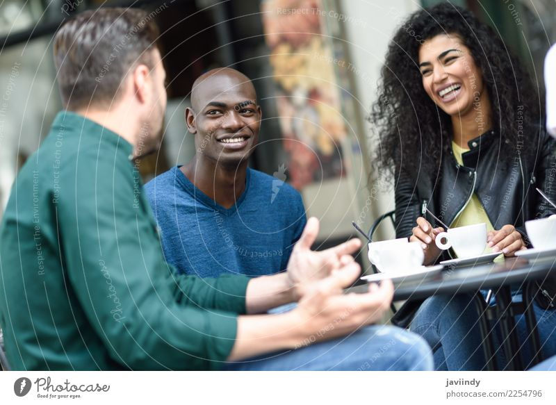Multiracial group of three friends having a coffee together Woman Human being Youth (Young adults) Man Young woman Summer Beautiful Young man Joy 18 - 30 years