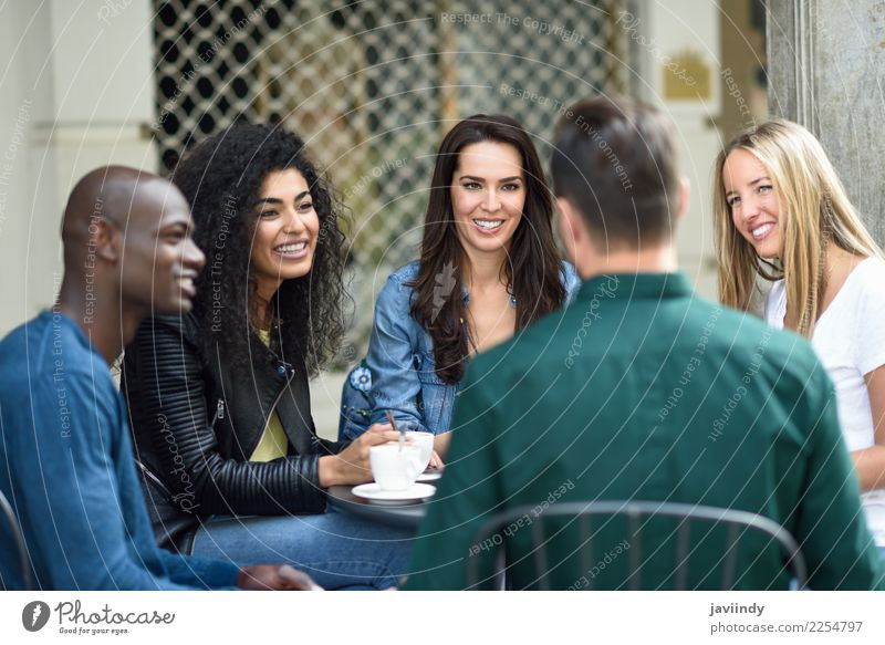 Multiracial group of five friends having a coffee together Woman Human being Youth (Young adults) Man Young woman Summer Beautiful Young man Joy 18 - 30 years