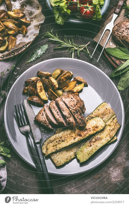 Food with fried meat, fried potatoes and vegetables Meat Vegetable Nutrition Lunch Dinner Organic produce Crockery Plate Cutlery Style Design Restaurant