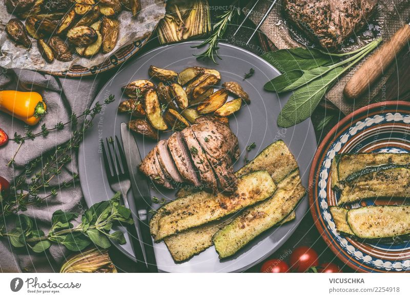 Fried meat, baked potatoes and vegetables Food Meat Vegetable Lettuce Salad Herbs and spices Nutrition Lunch Dinner Organic produce Crockery Plate Cutlery Style