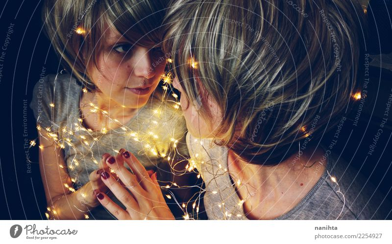 Young woman with fairy lights reflected in a mirror Human being Youth (Young adults) Christmas & Advent Joy 18 - 30 years Adults Love Feminine Style Moody