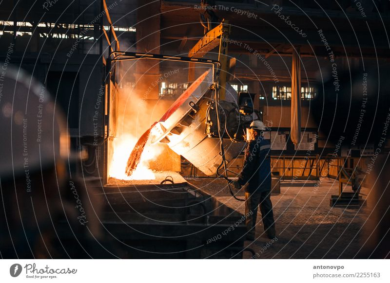 production of aluminium Factory Industry Human being Man Adults 1 Brown Yellow Gold Orange Red Steel Metal Production plant Entertainment industry Colour photo