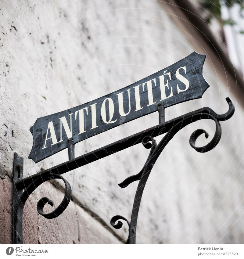ANTIQUITÉS Building Wall (barrier) Wall (building) Stone Sign Signs and labeling Old Sharp-edged Elegant Beautiful Antiques dealer Ancient Decoration