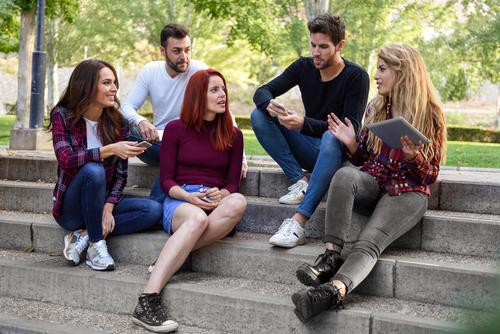 Group of young people together outdoors in urban background Woman Man Beautiful Joy Street Adults Lifestyle Autumn Laughter Happy Together Friendship Technology
