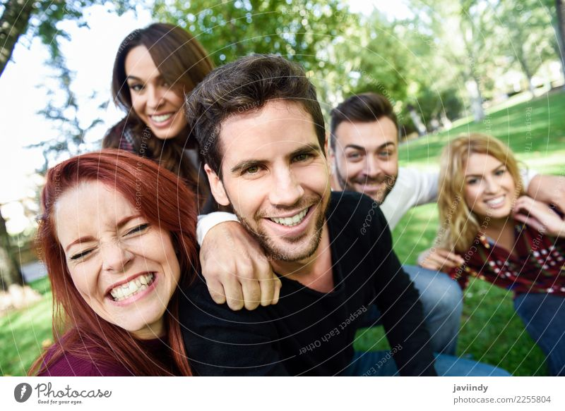 Group of friends taking selfie in urban background. Woman Man Beautiful Joy Street Adults Lifestyle Laughter Happy Together Friendship Leisure and hobbies Park