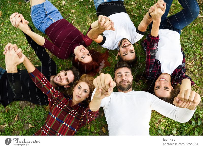 Women and men laying on grass wearing casual clothes. Lifestyle Joy Human being Masculine Feminine Young woman Youth (Young adults) Young man Woman Adults Man