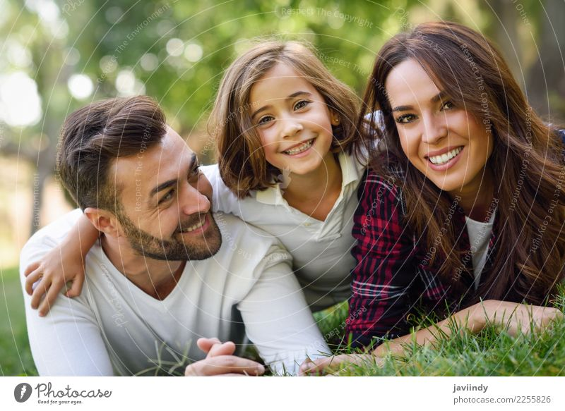 Father, mother and little daughter laying on grass. Lifestyle Joy Happy Beautiful Summer Child Human being Masculine Feminine Girl Young woman