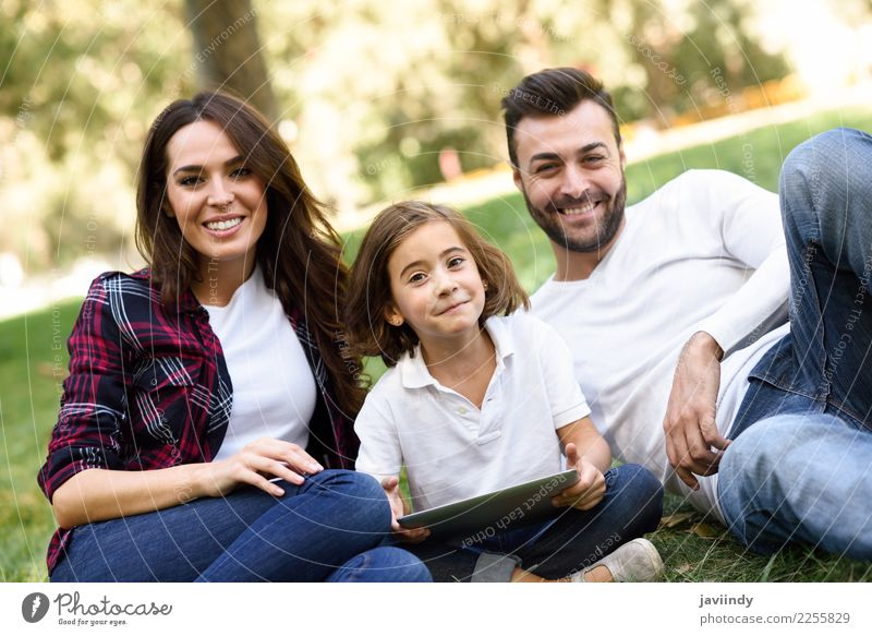 Happy family in a urban park playing with tablet computer Child Woman Human being Vacation & Travel Youth (Young adults) Man Summer Beautiful Joy Girl