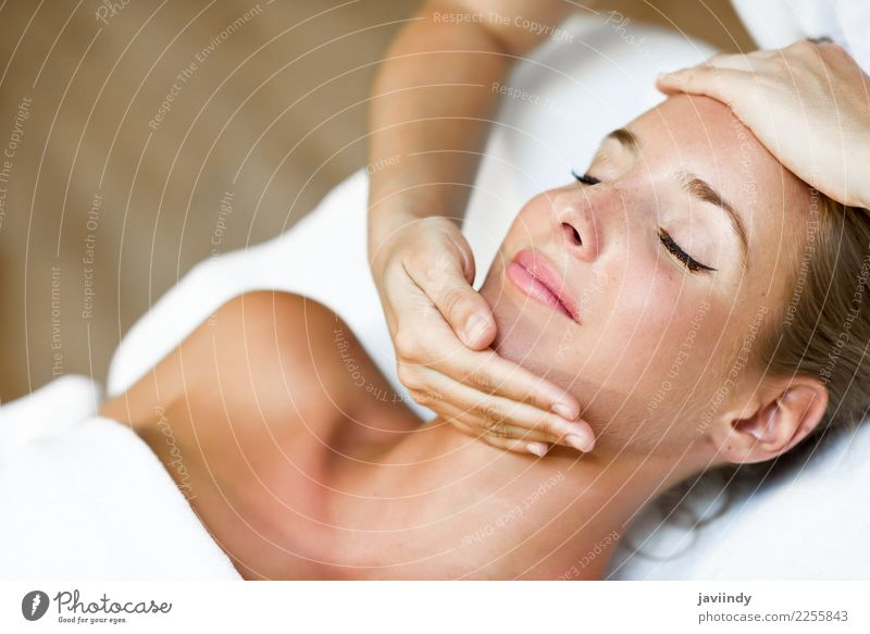 Woman receiving a head massage in a spa center Lifestyle Happy Beautiful Skin Face Health care Medical treatment Wellness Relaxation Spa Massage Human being
